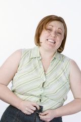 Studio portrait of overweight woman