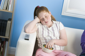 overweight girl sleeping on sofa