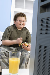 boy eating bowl of fruit