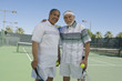 Two men on tennis court, portrait