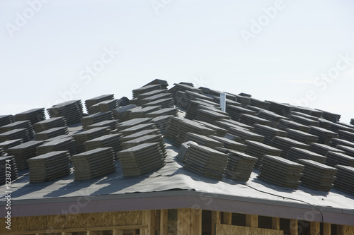 Stacks of tiles on building roof