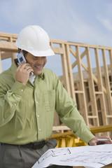 construction worker studying blueprint
