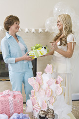 Bride receiving gift from friend at Bridal Shower