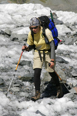 Alpinist on glacier.