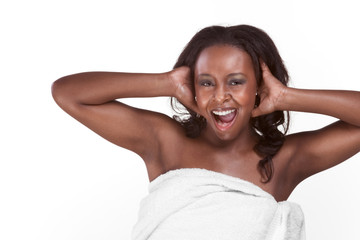 Black woman wrapped in bath towel screaming