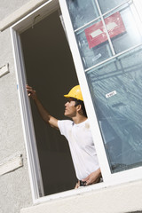 Construction Worker examining window frame
