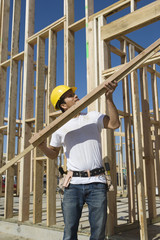 construction worker holding planks