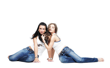 two girlfriends wearing blue jeans isolated  with copy space