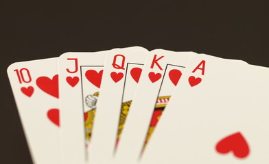 Poker in hearts on black isolated background.