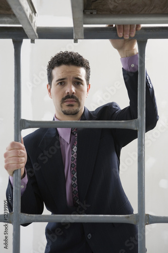 Businessman on scaffolding