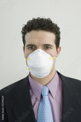 Businessman with mask on