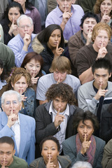 Crowd gesturing silence
