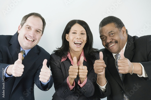 Three businesspeople with thumbs up