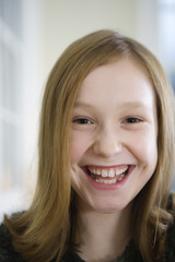 Portrait of a girl smiling.