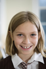 Portrait of cheerful girl wearing uniform.