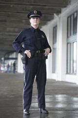 Female police officer standing.