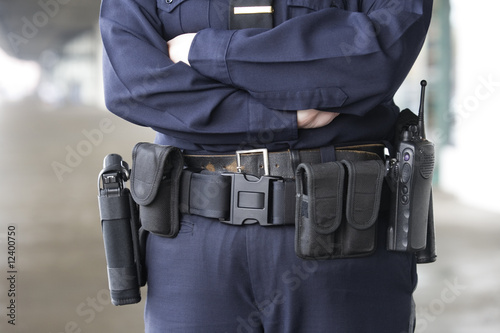 Midsection of a female police officer standing..
