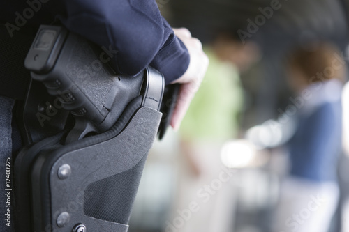Close up of a female police woman's gun in holster.