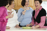 Cheerful women eating chips.