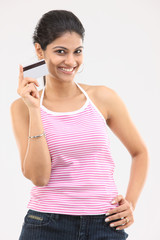 Young girl in pink dress holding credit card