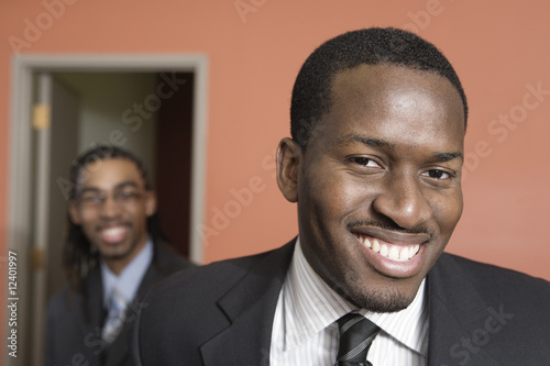 Portrait of smiling young businessmen.