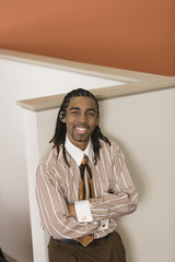 Portrait of a businessman smiling in an office.