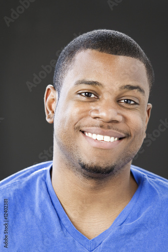 Portrait of young man smiling.