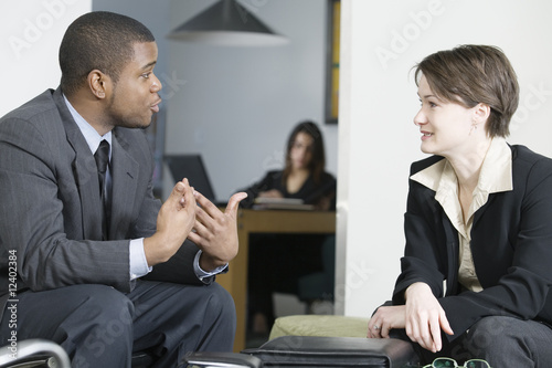 Business colleagues conversing in an office.