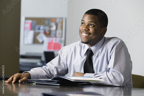 Business man smiling in an office.