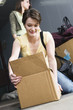 Woman packing cardboard box.