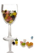 jelly beans in wine glass, reflected in glossy surface