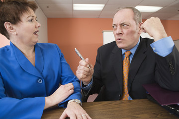 business man abusing business woman in an office.