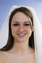 Portrait of a young bride smiling.