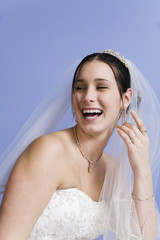 Cheerful bride in bridal gown..