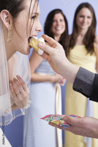 Side view of a bride eating cake.