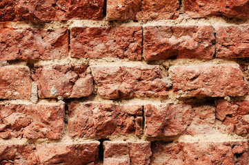 Rough wall from broken red bricks