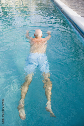 Senior man swimming in a pool