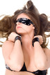 Sexy young woman in handcuffs and a bandage on eyes