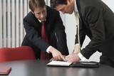 Business men working in an office.