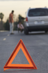 Warning triangle in front of broken down car