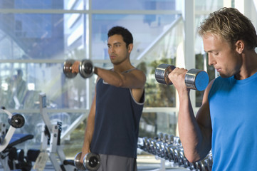 Men Weightlifting With Dumbbells