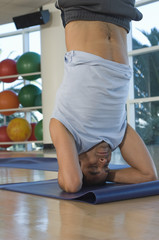 Man Practicing Yoga in Health Club
