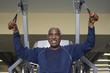 senior man working out on weightlifting machine