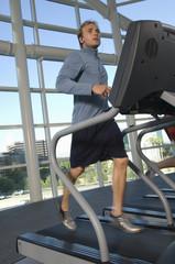 Man Jogging on Treadmill at Gym