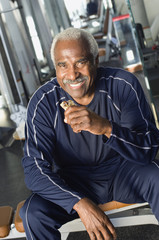 Senior Man Eating Healthy Snack at Gym