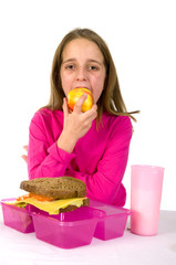 Little girl is having lunch