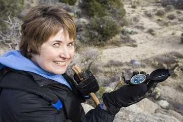 Middle-aged woman holding compass