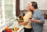 Affectionate Couple Enjoy Making Dinner Together poster
