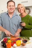 Happy Couple Preparing a Meal poster