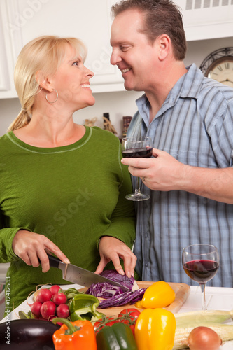 poster of Attractive Couple Prepare a Meal Together